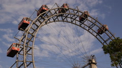 Stock Video Footage of Vienna Big Ferris Wheel Prater Park Entertainment Leisure Activity Sunlight Day
