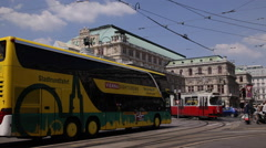 Stock Video Footage of Vienna Opernring Busy Road People Commuting Public Transportation Rush Hour Day