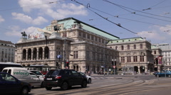 Old Red Tram Passing Crossing Intersection Cars Traffic Jam Vienna State Opera Stock Footage