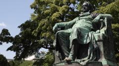 Monument Statue of Johann Wolfgang von Goethe Bronze Sculpture Vienna Burggarten Stock Footage