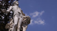 Stock Video Footage of Wolfgang Amadeus Mozart Statue Monument Burggarten Vienna Blue Sky Copy Space