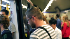 People entering subway on the station, steadycam shot Stock Footage
