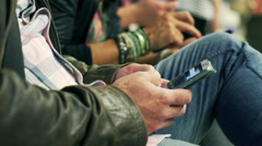 People using mobile phones on the station, steadycam shot - stock footage