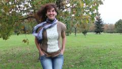 Woman at jeans jumping in autumn park. - stock footage
