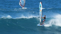 Maui, hi - february 1: professional windsurfer levi siver rides a wave at ho' Stock Footage