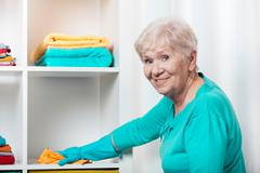 Stock Photo of senior woman cleaning house