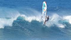 Maui, hi - february 1: professional windsurfer levi siver rides a wave at ho' Stock Footage