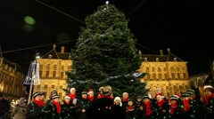 People sing Christmas Carols in Dam Square, Amsterdam, Holland Stock Footage