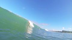 Maui, hi - december 15: professional surfer granger larson gets barreled ridi Stock Footage