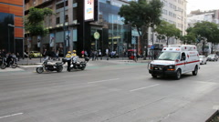 Ambulance riding through city in mexico Stock Footage