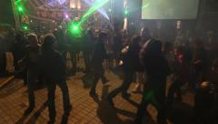 Young people students dancing at party with singing group at the stage - stock footage