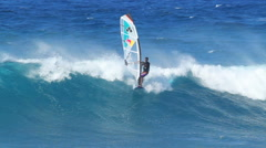 professional windsurfer levi siver rides a wave at ho' Stock Footage