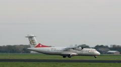 Etihad airplane taxiing on runway Stock Footage