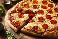 Hot homemade pepperoni pizza Stock Photos