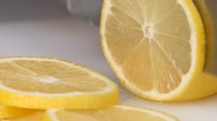 Knife a cutting juicy lemon on a white background Stock Footage