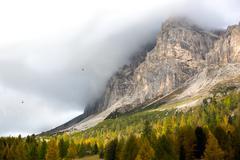 Autumn at Passo Falzarego, Dolomites, Italian Alps - stock photo