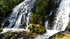 Beautiful waterfall in the mountains on sunny day, close up Stock Footage