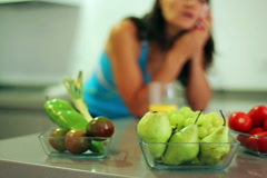 Healthy fruits and vegetables in kitchen woman talking cellphone, steadycam shot - stock footage