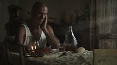 Desperate sad man alone in the kitchen: suicide, depression, depressed, sadness Stock Footage