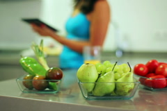 Fruits and vegetables in bowls lying on worktop in the kitchen, steadycam shor Stock Footage