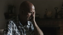 Pensive sad man sitting alone: thoughtful, deep in problems, sadness, loneliness Stock Footage