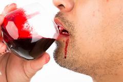 halloween vampire drink blood on white background - stock photo