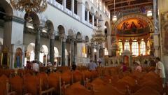 People inside Church of Saint Demetrios in Thessaloniki, Greece Stock Footage