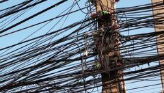 Large number of electrical wires on electric post Stock Footage