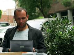 Man drinking coffee and working on laptop early in the morning Stock Footage
