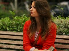 Impatient woman waiting for someone on the bench, steadycam shot - stock footage