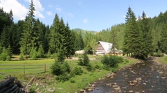 Cottage near mountain river in Carpathians, Ukraine Stock Footage