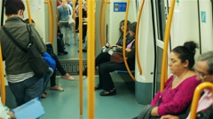 People standing and sitting in the metro, steadycam shot Stock Footage