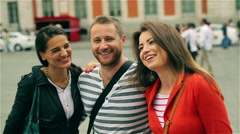 Friends smiling to the camera and going round, steadycam shot Stock Footage