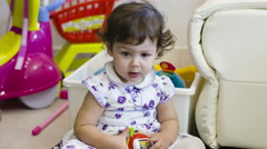 A little girl playing carefree in the living room with her toys: kid, Child, Stock Footage