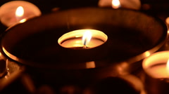 Candles burning at altar Stock Footage