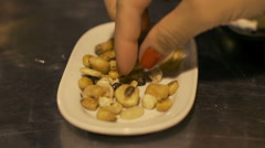 People picking up nuts from the plate, steadycam shot Stock Footage