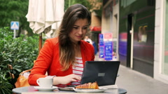 Stylish woman working on notebook in the street cafe Stock Footage