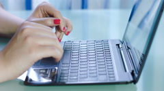 Woman's hands typing on a notebook keyboard: web, internet, searching, computer Stock Footage