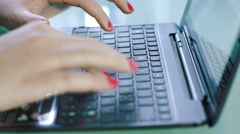 Woman using laptop on the desk: notebook computer, internet, netbook Stock Footage