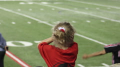 Child covering ears due to noise level at sporting event Stock Footage