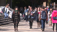 Stock Video Footage of college and univeristy students on campus walking to classes
