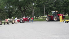 Several tractors in line for a parade - stock footage