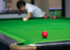 snooker balls on green snooker table - stock photo