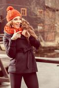 smiling young woman in autumn scenery - stock photo