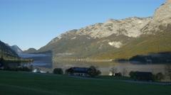 4k idyllic Austrian alpine lakeside village Stock Footage