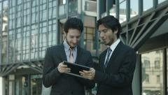 business people using tablet near office: team working, coworkers, business life - stock footage