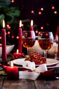 Christmas gift in dishware at the wooden table Stock Photos