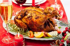Baked chicken for christmas dinner on festive table Stock Photos