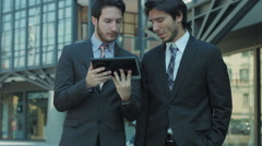 Coworkers using tablet near office: working team using social network and web Stock Footage