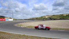 Alfa Romeo race cars on track Stock Footage